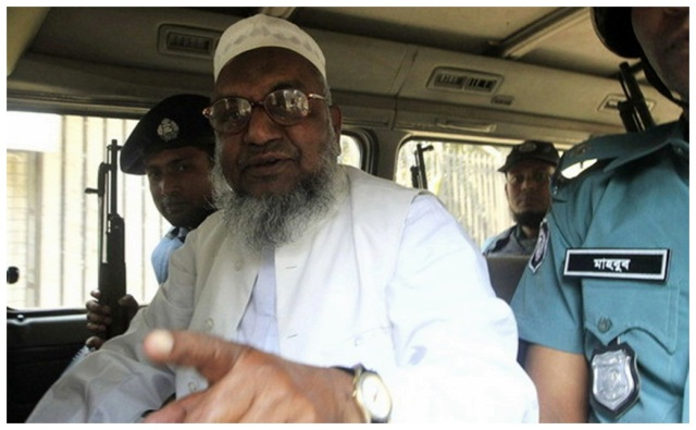 Bangladesh's Jamaat-e-Islami leader Abdul Quader Mollah gestures as he talks from a police van after a war crimes tribunal sentenced him to life imprisonment in Dhaka